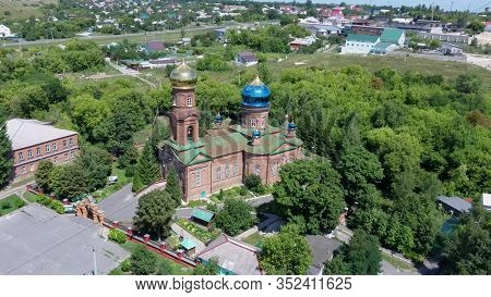 Red Brick Christian Church With Golden Domes. Christian Temple In Russia. The Church Of The Christia