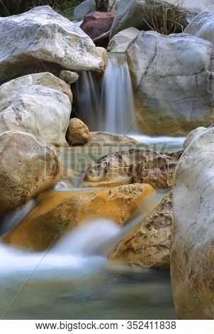 Landscape with small waterfall on mountain river