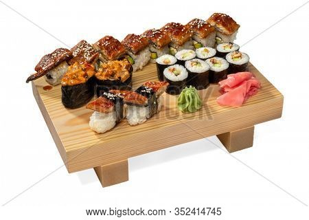 Dragon Roll with Unagi/anago (eel—unagi refers to freshwater and anago to saltwater),  Guncan, Kappa maki on wooden board isolated on white background