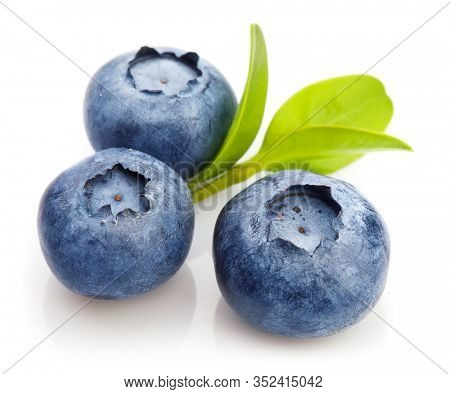 Berry blueberry with leaf mint close-up. Fruity still life for organic healthy food, isolated on white background.