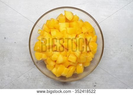 Sliced Peach In A Glass Plate On A Gray Background With Marble Cracks And Specks. The Concept Of Hea