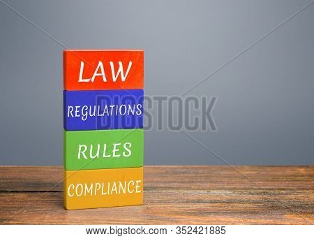 Colored Blocks With Words Law, Regulations, Rules, Compliance. Ease Doing Business. Quality Criteria