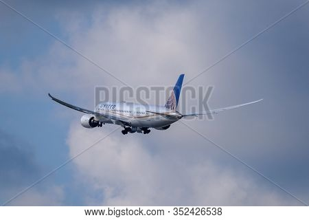 Zurich, Switzerland - July 19, 2018: United airlines airplane preparing for landing at day time in international airport