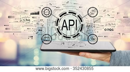 Api - Application Programming Interface Concept Api Concept With Man Holding A Tablet Computer