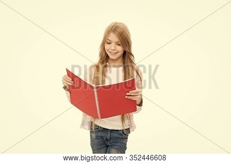 Book Store Concept. Pad Perfect For Keeping Note. Adorable Little Girl With Colorful Writing Pad. Cu