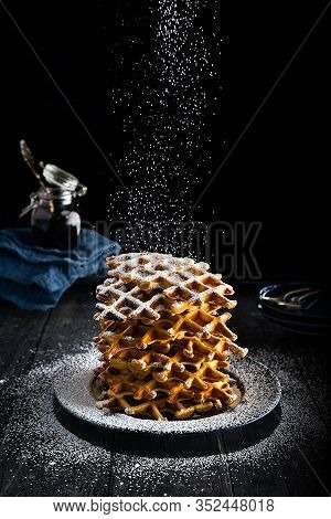 Fluffy And Delicious Waffles Dusted With Icing Sugar