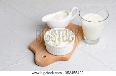 Homemade Fermented Milk Products - Kefir, Sour Cream, Cottage Cheese On A Wooden Board On A White Ba