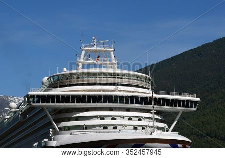 In the marina of famous Flam . Tourism vacation and travel. Mountains landscape and big cruise ship on fjord Sognefjord.June 17,2018. Flam Norway Scandinavia.