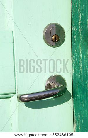 Closeup Of An Old Wooden Door In Green
