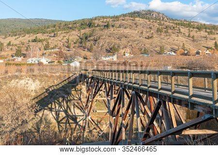 Wooden Trestle Bridge Across A Ravine On The Kettle Valley Rail Trail In The Okanagan Valley