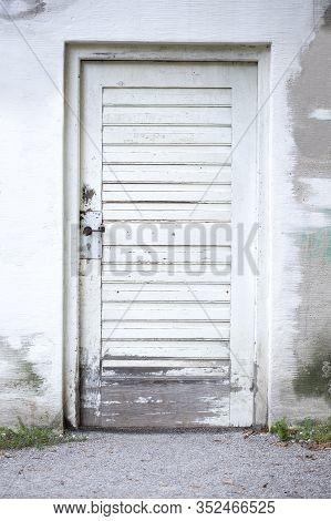 Closeup Of An Old Wooden White Door