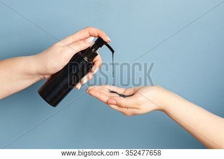 Womens Hands Applying Black Cleansing Oil With Charcoal To Cleanse The Skin