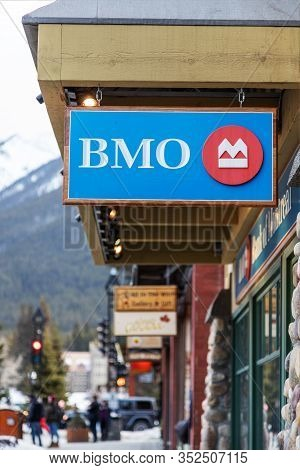 Banff, Canada - Feb 15, 2020 : Bmo Bank Of Montreal Branch With Its Sign On Busy Banff Avenue In Alb