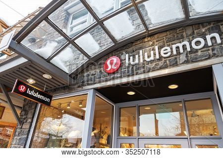Banff, Canada - Feb 15, 2020 : Lululemon Store With Its Sign On Busy Banff Avenue In Alberta, Canada
