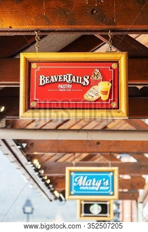 Banff, Canada - Feb 15, 2020 : Famous Canada-based Beavertails Restaurant With Its Sign On Busy Banf