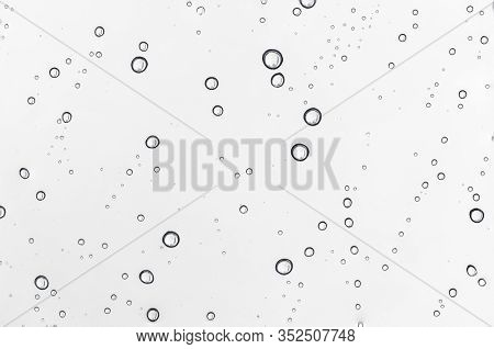 Rain Water Drops  On Clear Window.  Natural Pattern Of Raindrops. Autumn  Depressive Background.