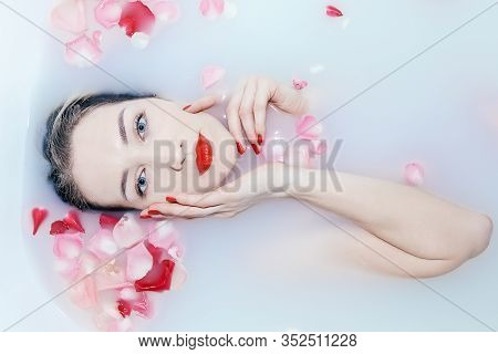 Young Sexy Girl Taking A Milk Bath With Rose Petals