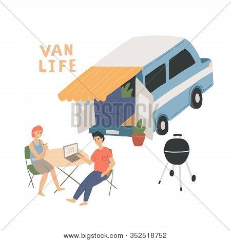 Couple Sitting At The Table Near Their Campervan. Man And Woman Living In A Van