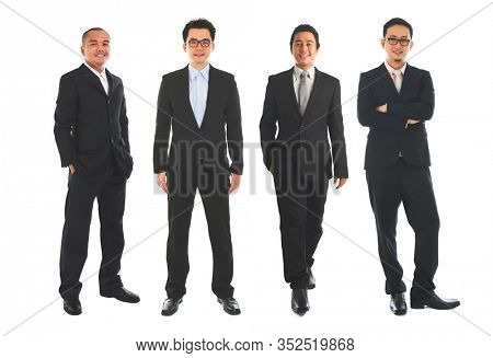 Full length Asian business man standing isolated on white background.
