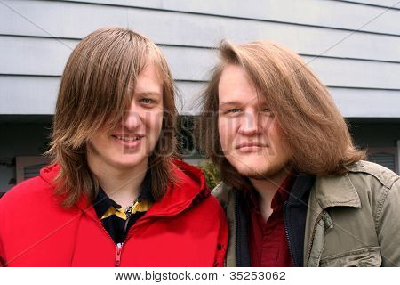 Long-haired Teen Brothers