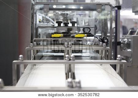 A Fragment Of A Dairy Factory. Dairy Factory. Tape Of Delivery Of Finished Packaged Products. Convey