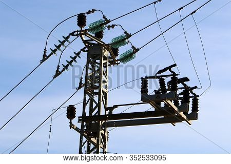 A Metal Electric Pole With Current Insulators And Wires Through Which Current Flows Is Installed In