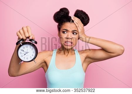 Photo Of Funny Dark Skin Lady Hold Metal Classic Alarm Clock Hand On Head Grimacing Oversleep Missed