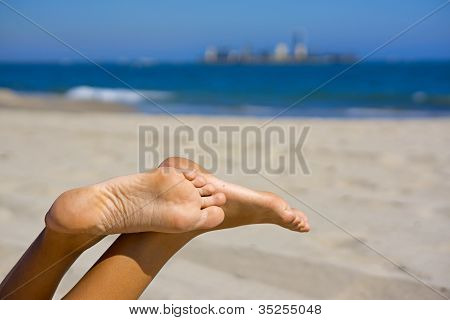 Beach Feet With Island In The Distance