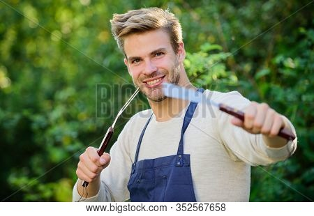 Cooking Burgers. Man Hold Barbeque Equipment. Grilling Food. Barbecue Utensils. Summer Weekend. Tool