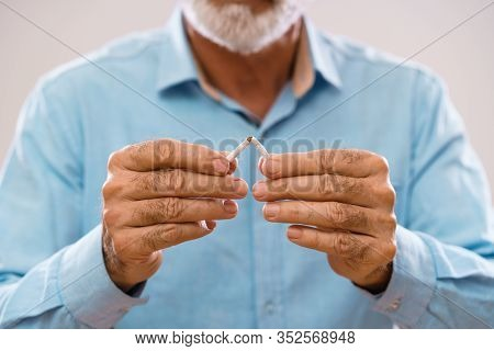 Serious Senior Man Is Decided To Quit Smoking.