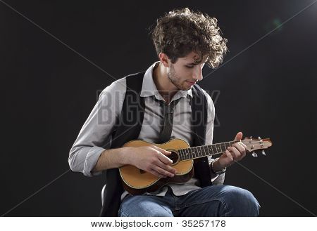 Young Man Playing A Ukelele