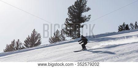 Skier Going Down The Mountain