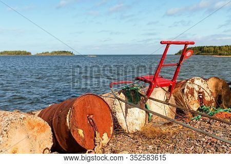 Someone Has Left A Traditional Red Kicksled By The Old Barrels At The Fishing Harbour In Kalajoki, F