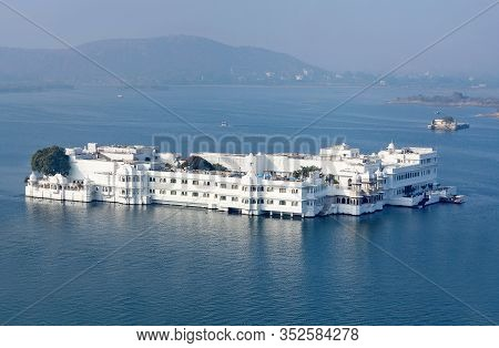 Panorama Of Taj Lake Palace Over Water. It Is Situated On The Island Of Jag Niwas On The Lake Pichol