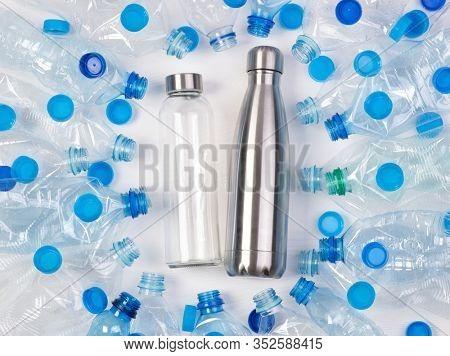 Reusable glass and metal bottles among plenty of plastic bottles