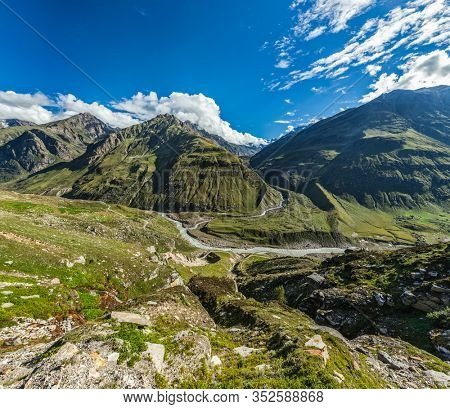 View of Lahaul valley from descend from Rohtang La pass - Chandra river and road Himachal Pradesh, India