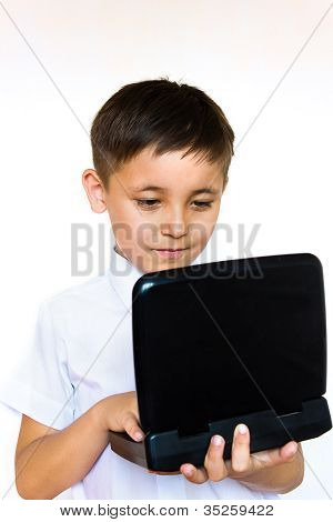 A Little Boy Enthusiastically Looking At Laptop