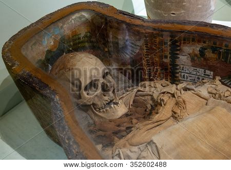 Istanbul, Turkey - March 21, 2019: Mummy skull of Sidonian King at Istanbul Archaeology Museum. Ancient skeleton head in crypt. Buried old mummified human body