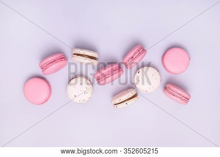 Pink And White Macarons On Blue Background French Dessert Caramel And Strawberry Macarons Horizontal