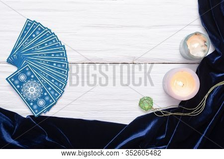 Blue Tarot Cards On White Wooden Table Background With Copy Space.