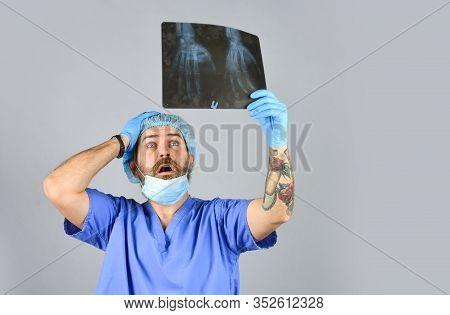 Doctor Examines Radiographic Snapshot Of Wrist. Surgeon Estimate Damages. Hospital Emergency. Doctor