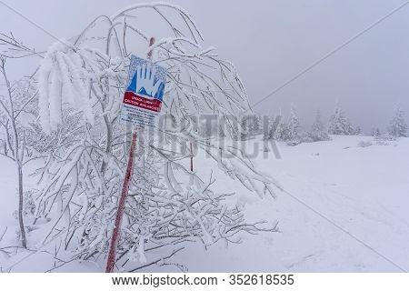 Sign Informing About Avalanches On A Mountain Trail In Winter. Tatry.