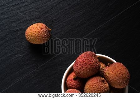 Litchi Fruits On A Black Background. Minimal Fruit Summer Concept.