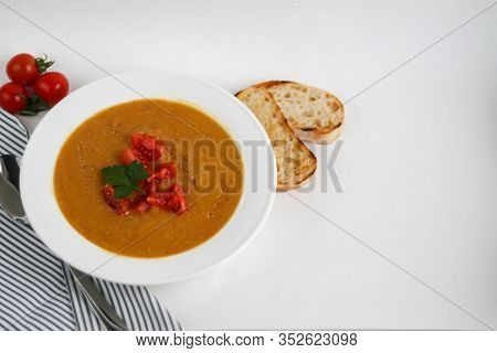 Vegetable Soup With Lentils On A White Background. Served With Chopped Cherry Tomatoes And Herbs. Ne