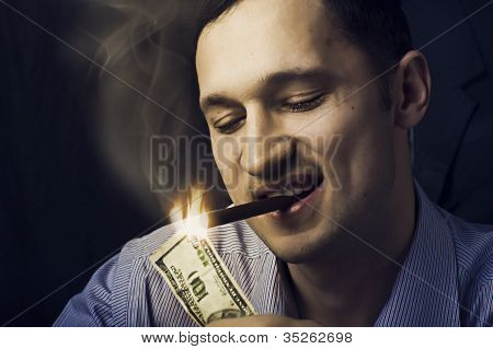 Man Lighting His Cigar With $100 Note
