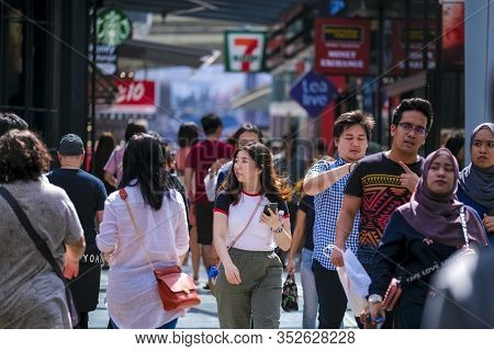 A Crowd Of People At Bukit Bintang Or Star Hill, A Tourist Attraction Place