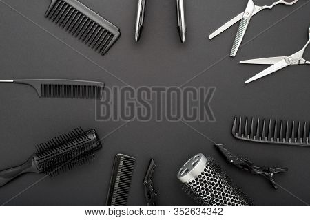 Flat Lay Composition With Hairdresser Tools: Scissors, Combs, Hair Iron On Black Background With Cop