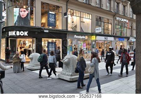 Stockholm, Sweden - August 22, 2018: People Visit Drottninggatan Shopping Street In Norrmalm Distric