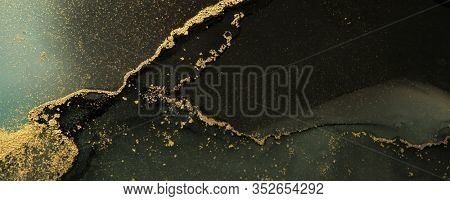 Abstract black and gold color horizontal background. Marble texture. Alcohol ink colors.