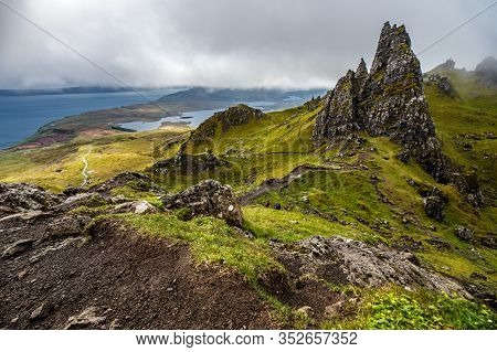 Old Man Of Storr On The Isle Of Skye In Scotland. Mountain Landscape With Foggy Clouds.